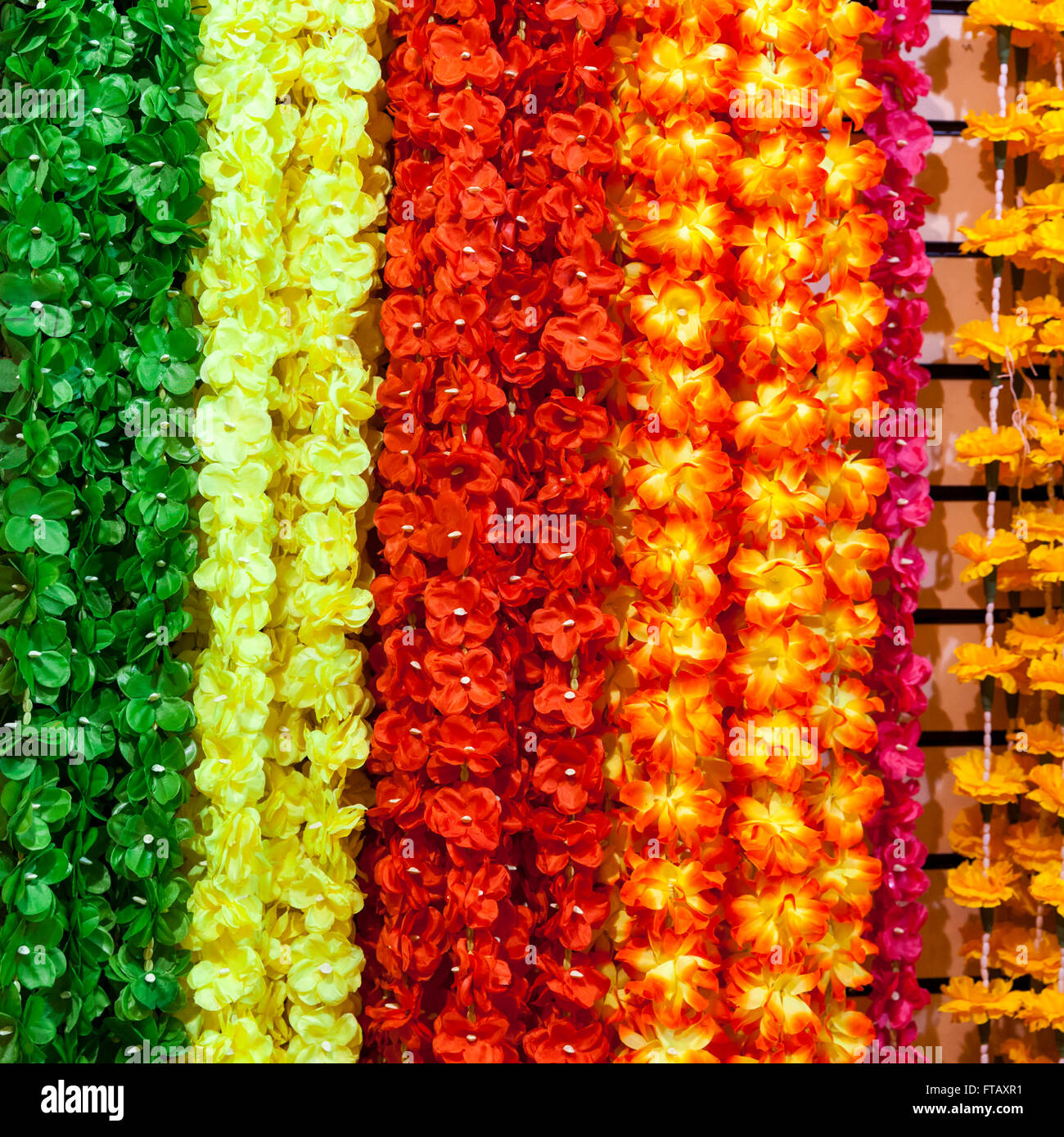 Indian decorative flower garlands on display - Stock Image