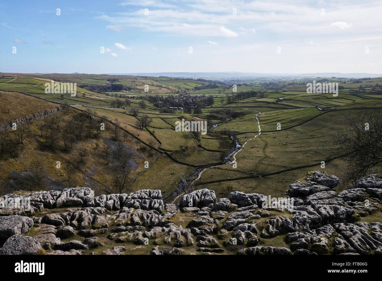 View from the top of Malham Cove, Yorkshire Dales National Park, UK showing limestone pavement. - Stock Image