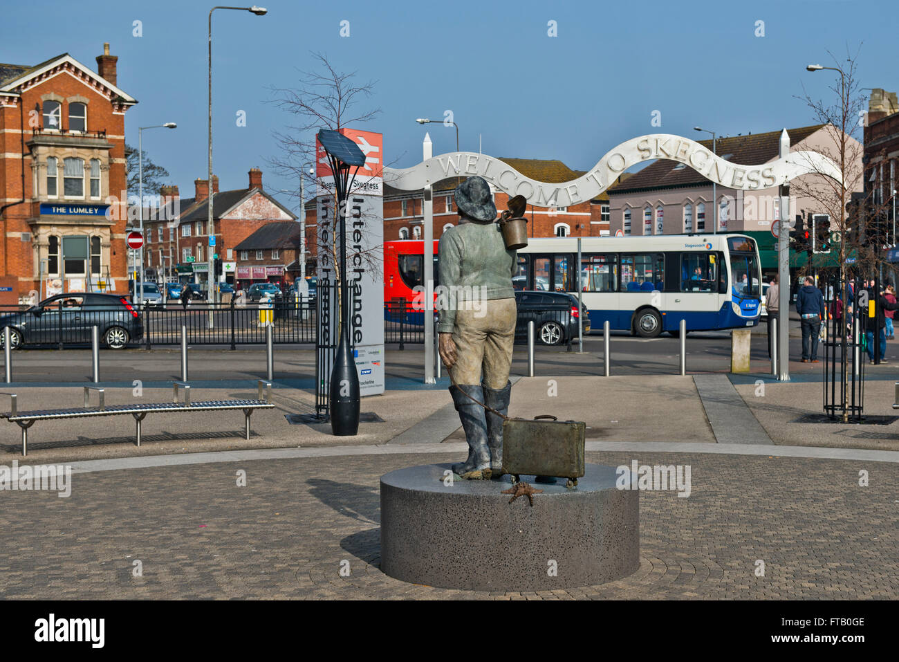 The Jolly Fisherman statue and the towns mascot stands outside the Skegness Railway Station. - Stock Image
