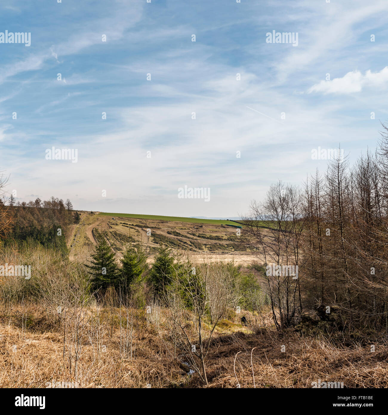 Looking across the valley towards the motor cycle scramble track on the opposite hill. - Stock Image