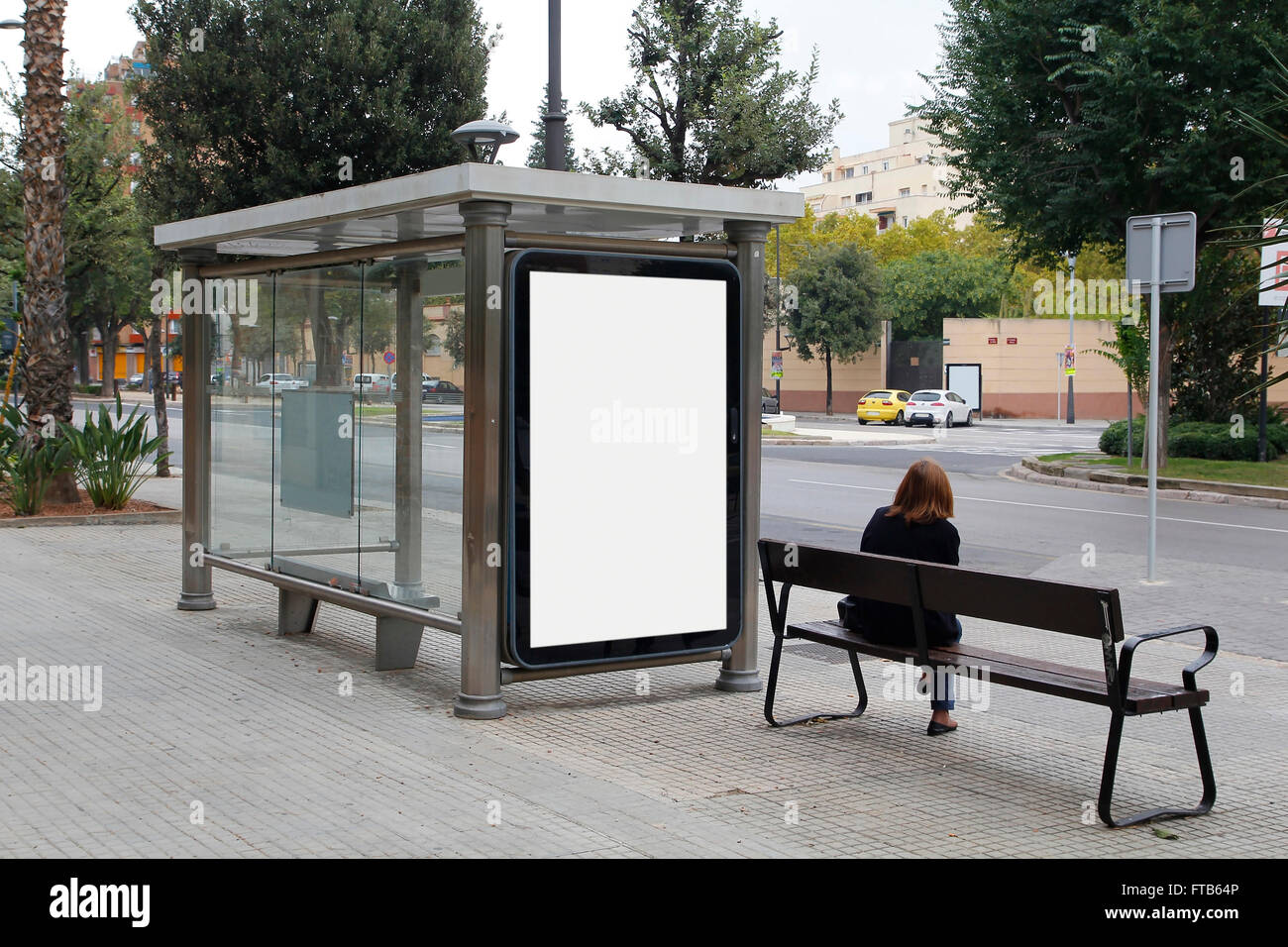 Blank billboard in a bus stop, for advertisement at the street - Stock Image