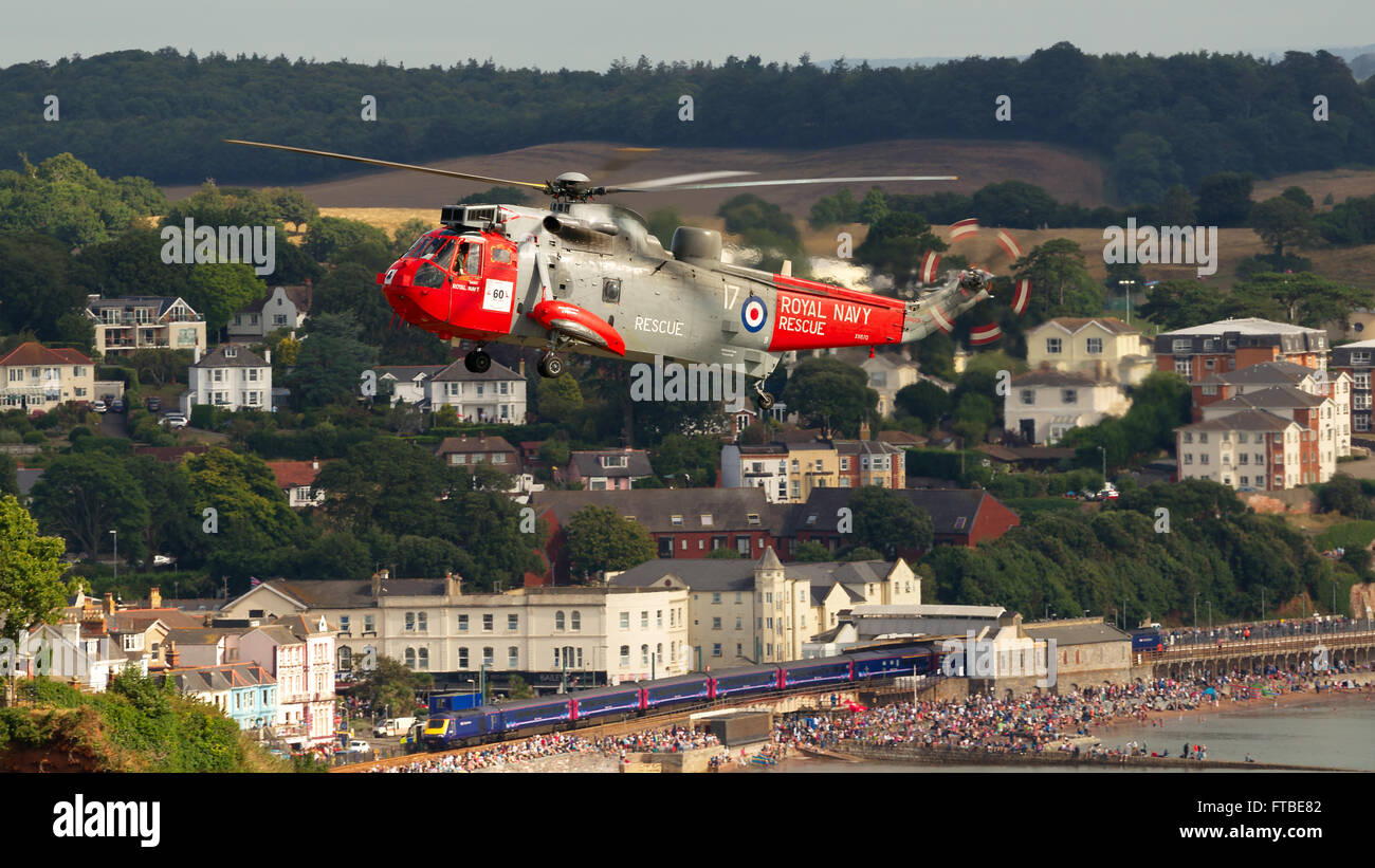 Sea King mk5 (Royal Navy) at Dawlish Airshow 24/08/2013, with First Great Western train in the background. Stock Photo