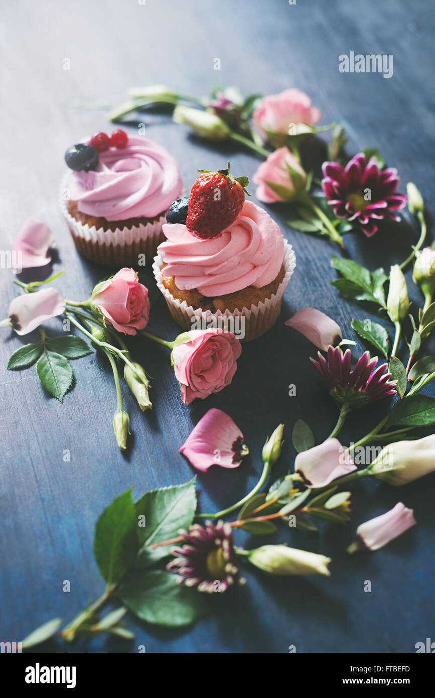 Strawberry cupcakes  with flowers - Stock Image
