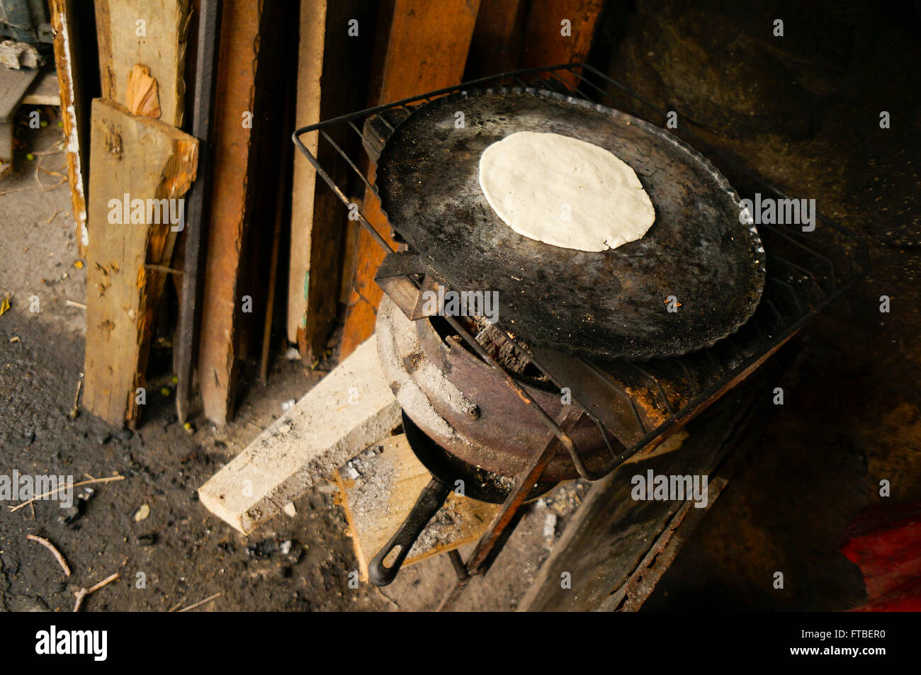 tortilla cooking on wood burning stove in Acapulco, Mexico - Stock Image