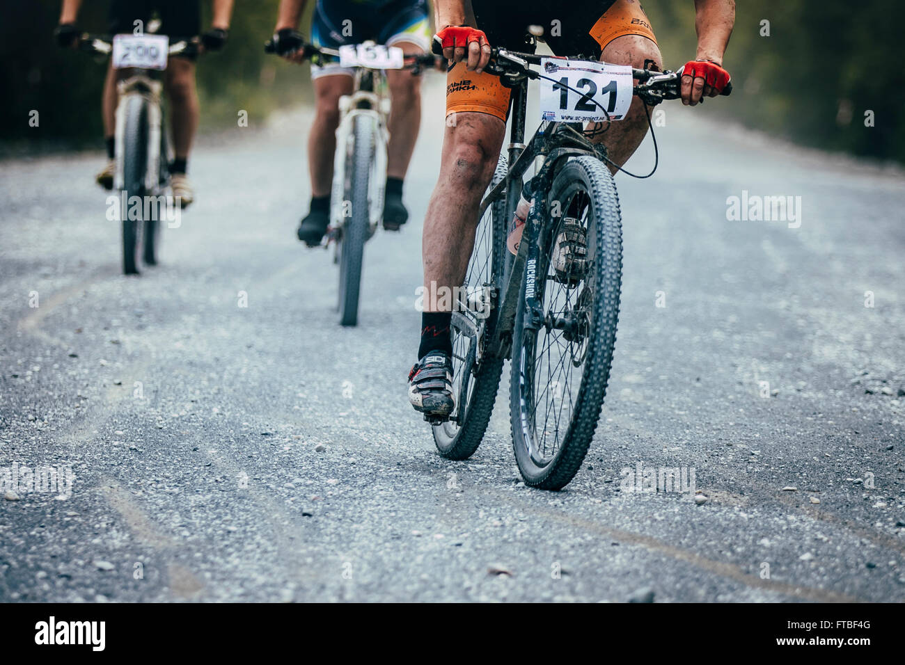 V.Ufaley, Russia - August 09, 2015:   group mountain bikers turns gravel road during race 'Big stone' - Stock Image