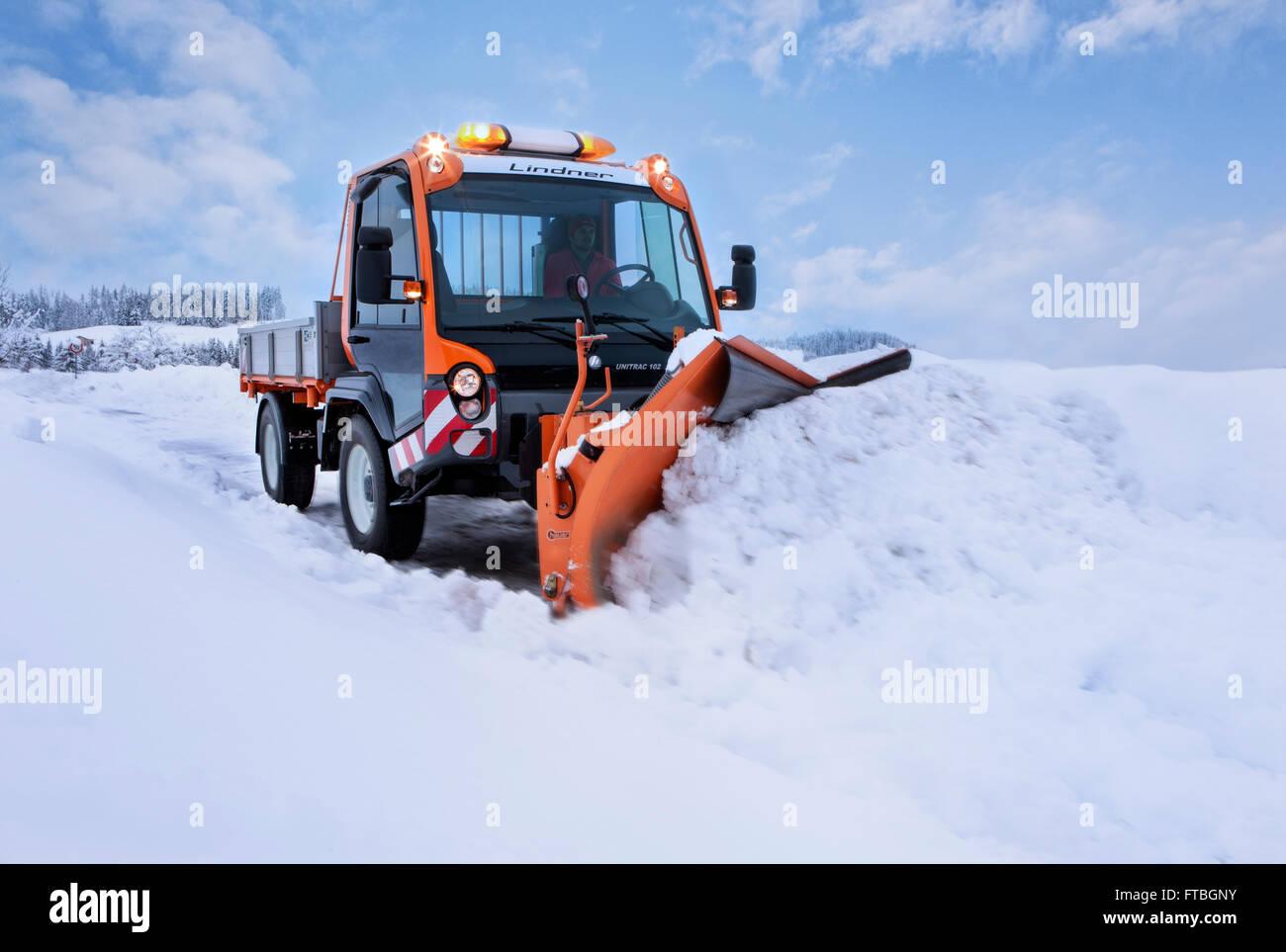 Snowplow removing snow, winter maintenance, Inn Valley, Kufstein district, Tyrol, Austria - Stock Image