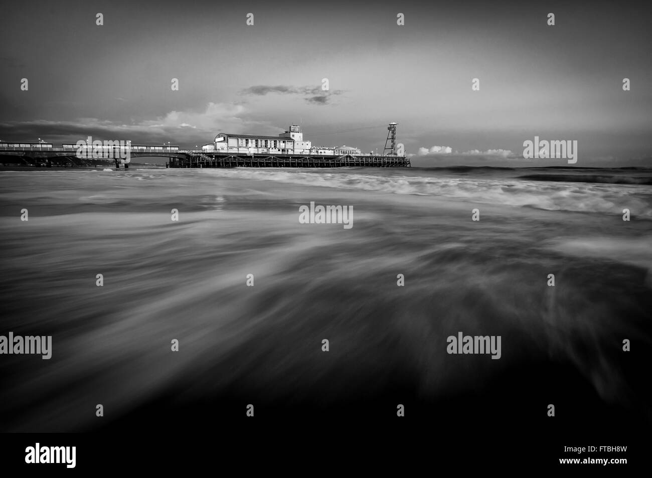 A black and white conversion of Bournemouth Pier in Dorset. - Stock Image
