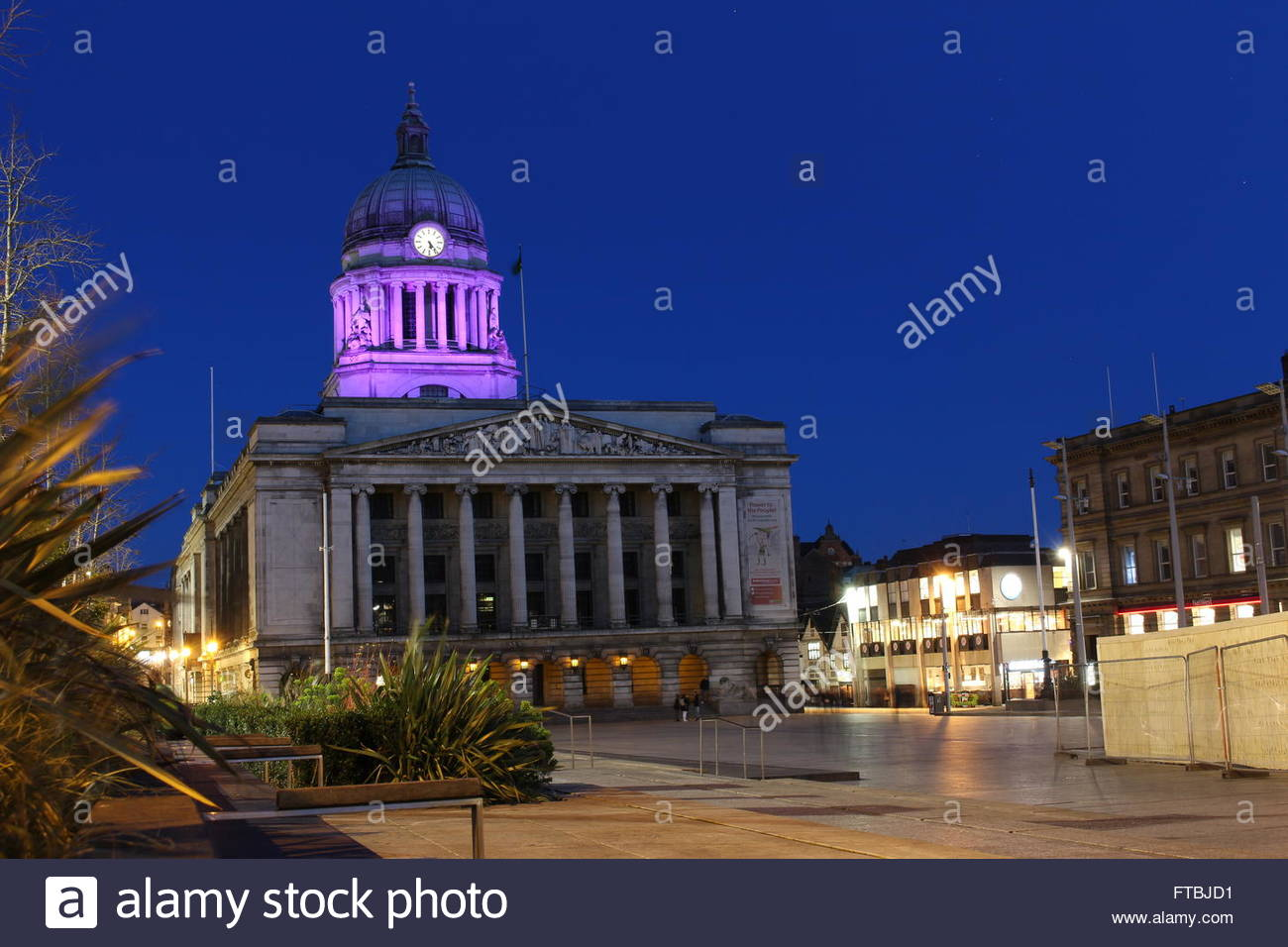 Nottingham Council House lit up with purple lights in peaceful mid-evening city scene. - Stock Image