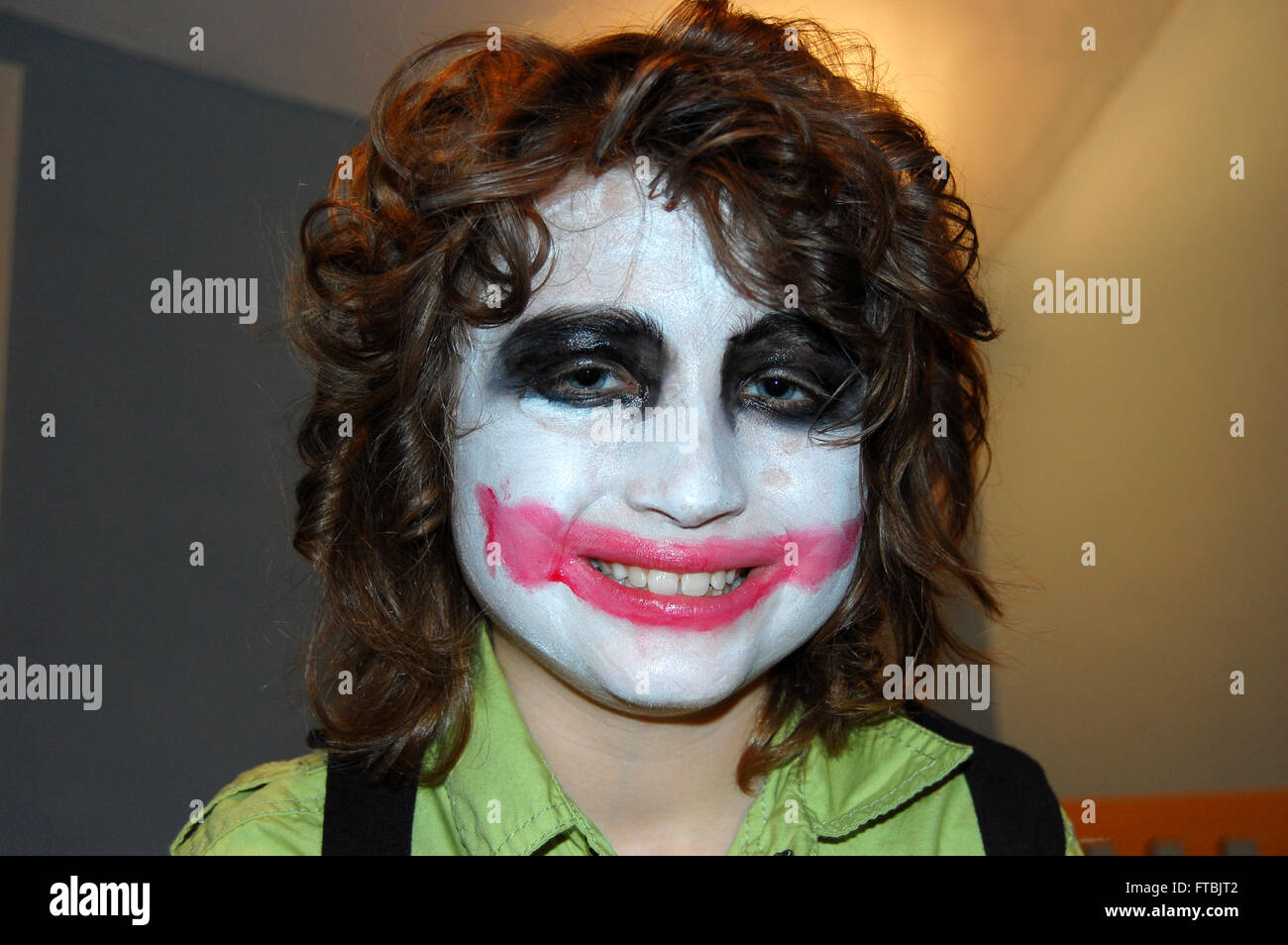 smiling boy in full halloween joker makeup stock photo: 101059842