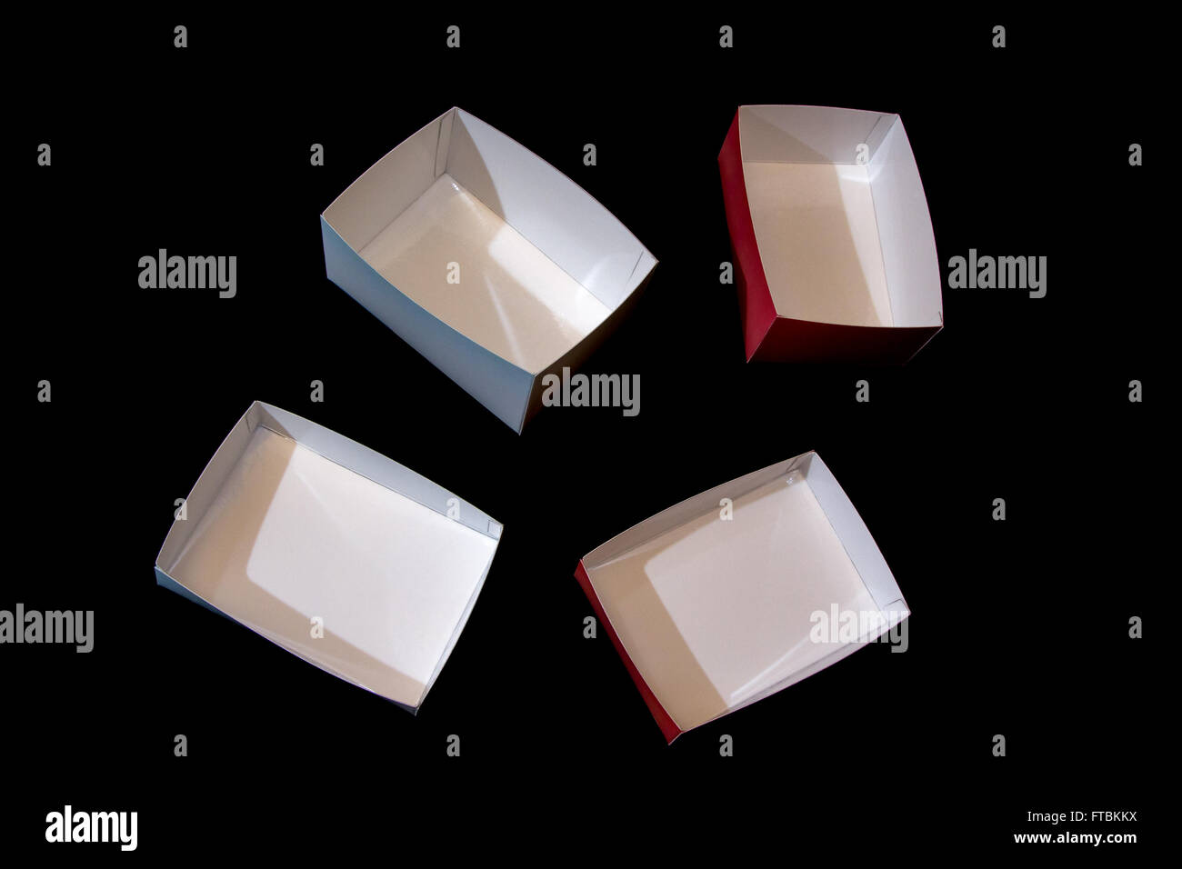 four small colored boxes made of laminated paper - Stock Image