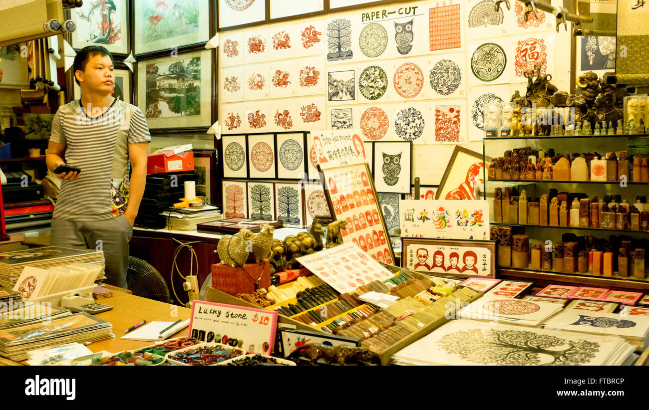 Stamps and works of paper art in Chinatown - Stock Image