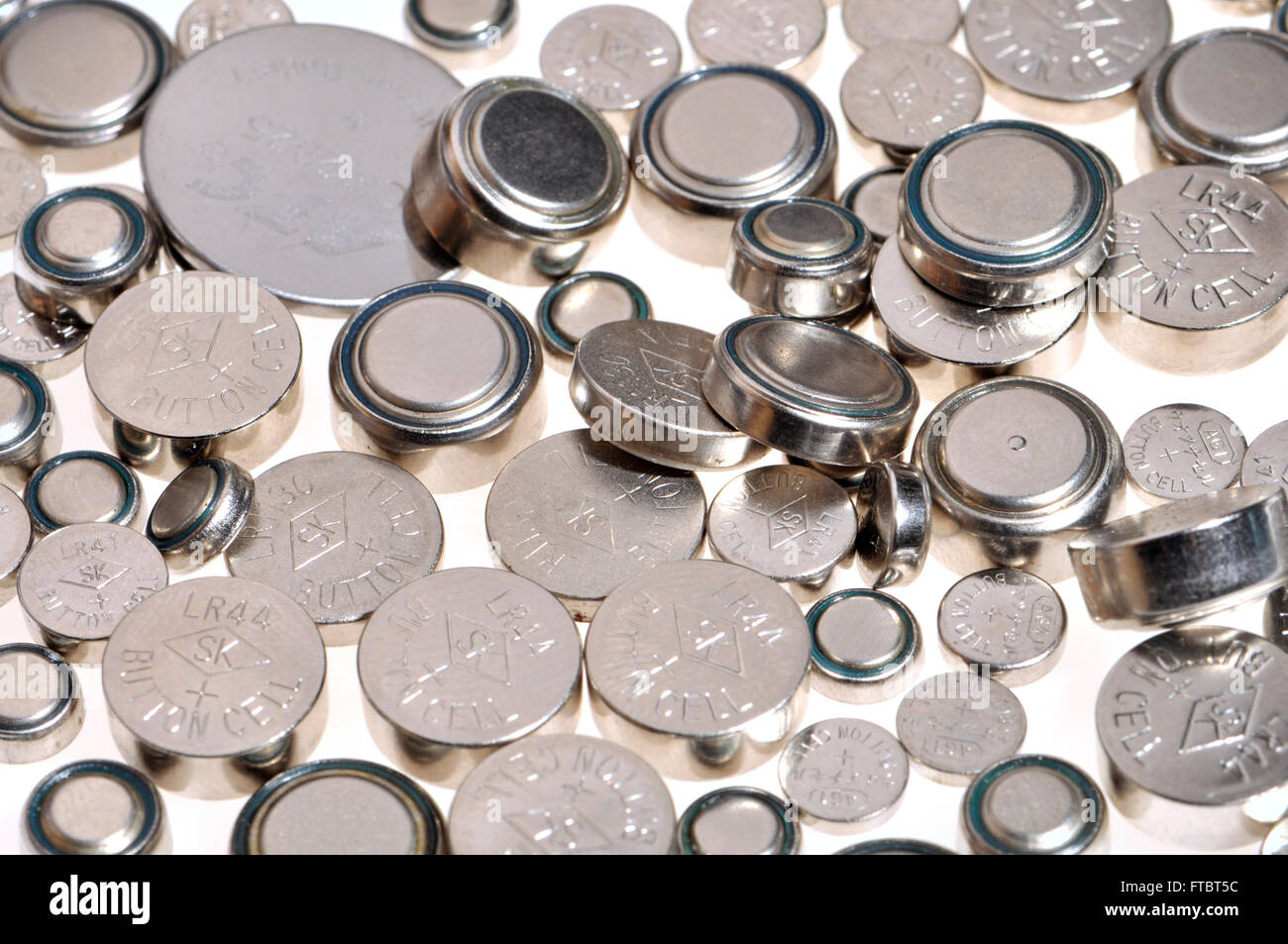 Button cell batteries for electronic devices - various sizes - Stock Image