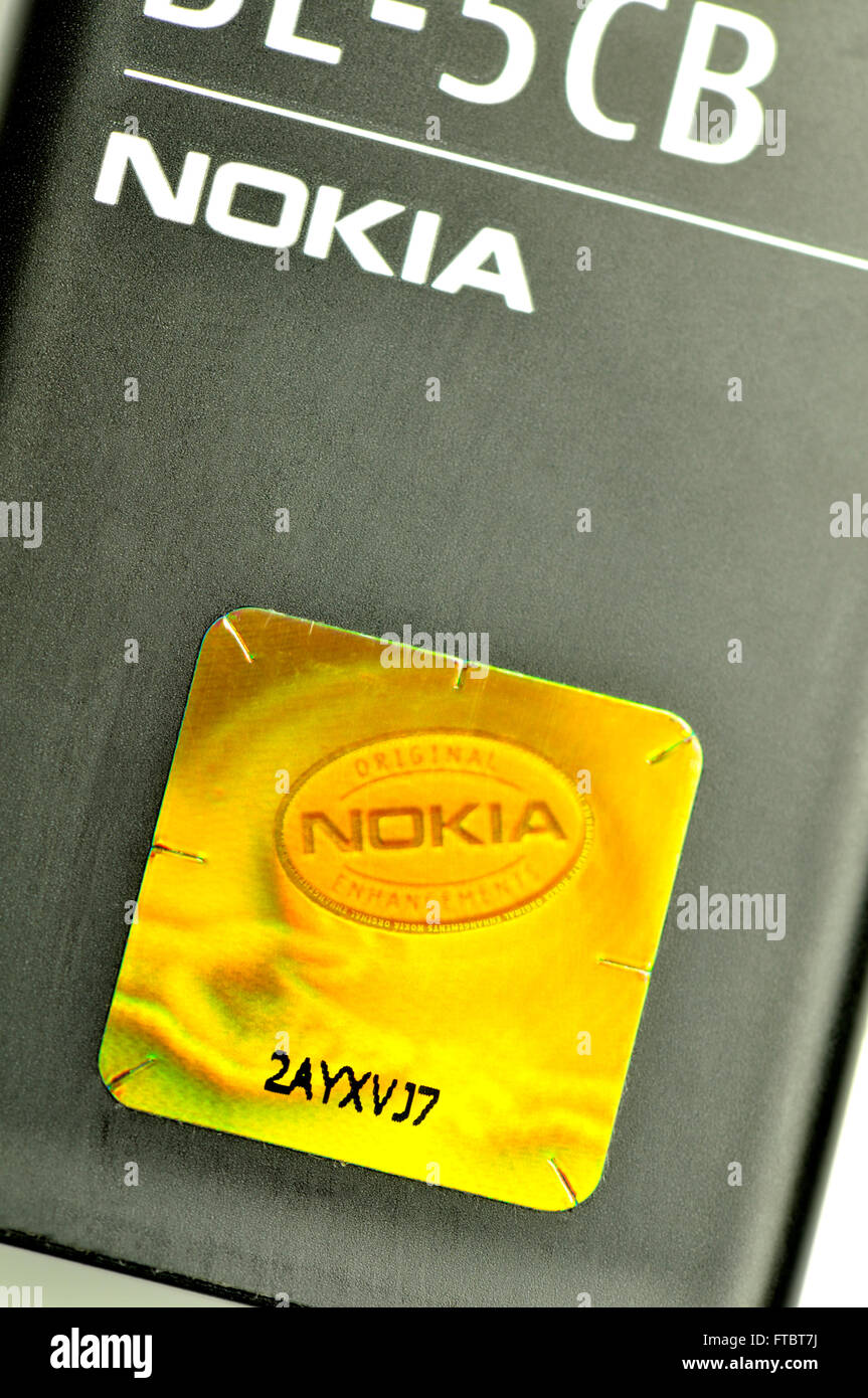 Holographic security label on a Nokia mobile phone battery - Stock Image