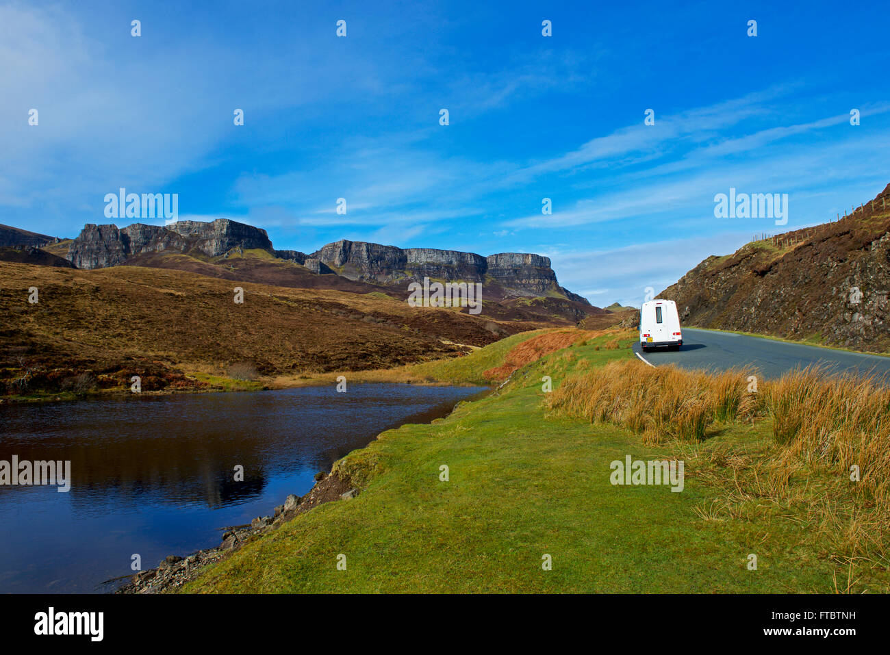 Small motorhome parked next to Lochan near Brogaig, Isle of Skye, Inner Hebrides, Scotland UK - Stock Image