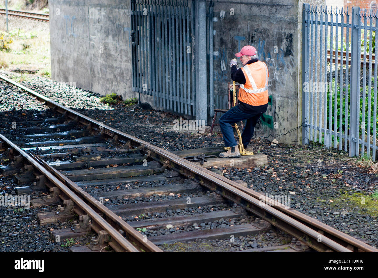 Whitehead, Co Antrim,UK 28th March 2016 . A railwayman Changing signals by hand - Stock Image