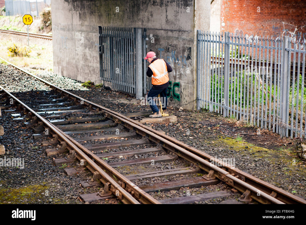 Whitehead, Co Antrim,UK 28th March 2016 . A railwayman Changing signals by hand using a lever - Stock Image