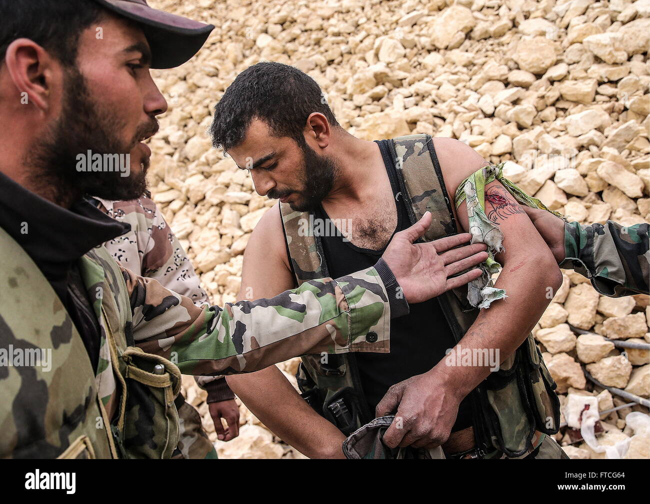 Palmyria, Syria. 26th Mar, 2016. A wounded soldier of the Syrian government army near Fakhr al-Din al-Maani Citadel - Stock Image