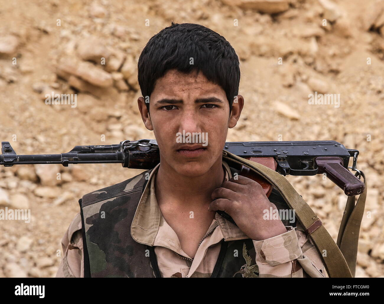 Palmyria, Syria. 26th Mar, 2016. Syrian government army soldier Akhmad (17) near Fakhr al-Din al-Maani Citadel in - Stock Image