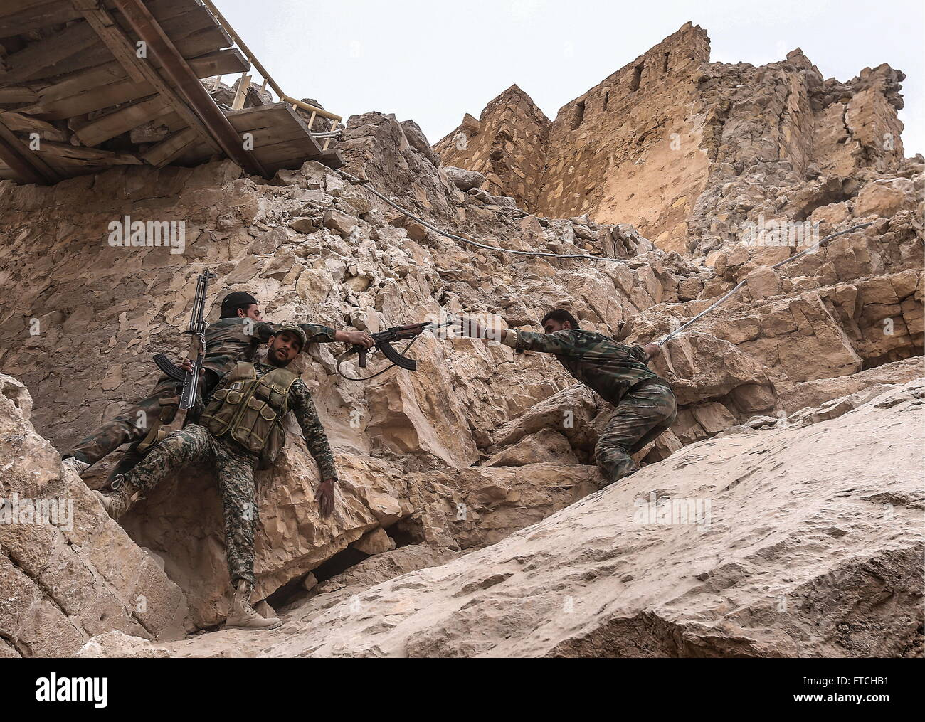 Palmyria, Syria. 26th Mar, 2016. Syrian government army soldiers on their way to the top of Fakhr al-Din al-Maani - Stock Image