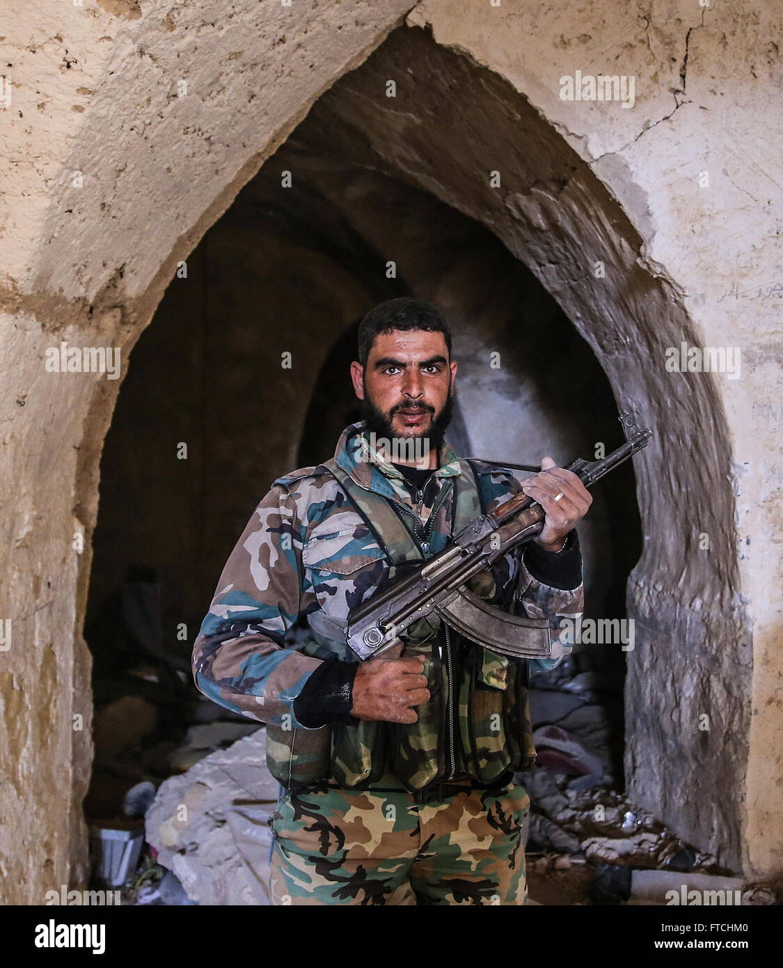 Palmyria, Syria. 26th Mar, 2016. A Syrian government army soldier in Fakhr al-Din al-Maani Citadel in Palmyra, a - Stock Image