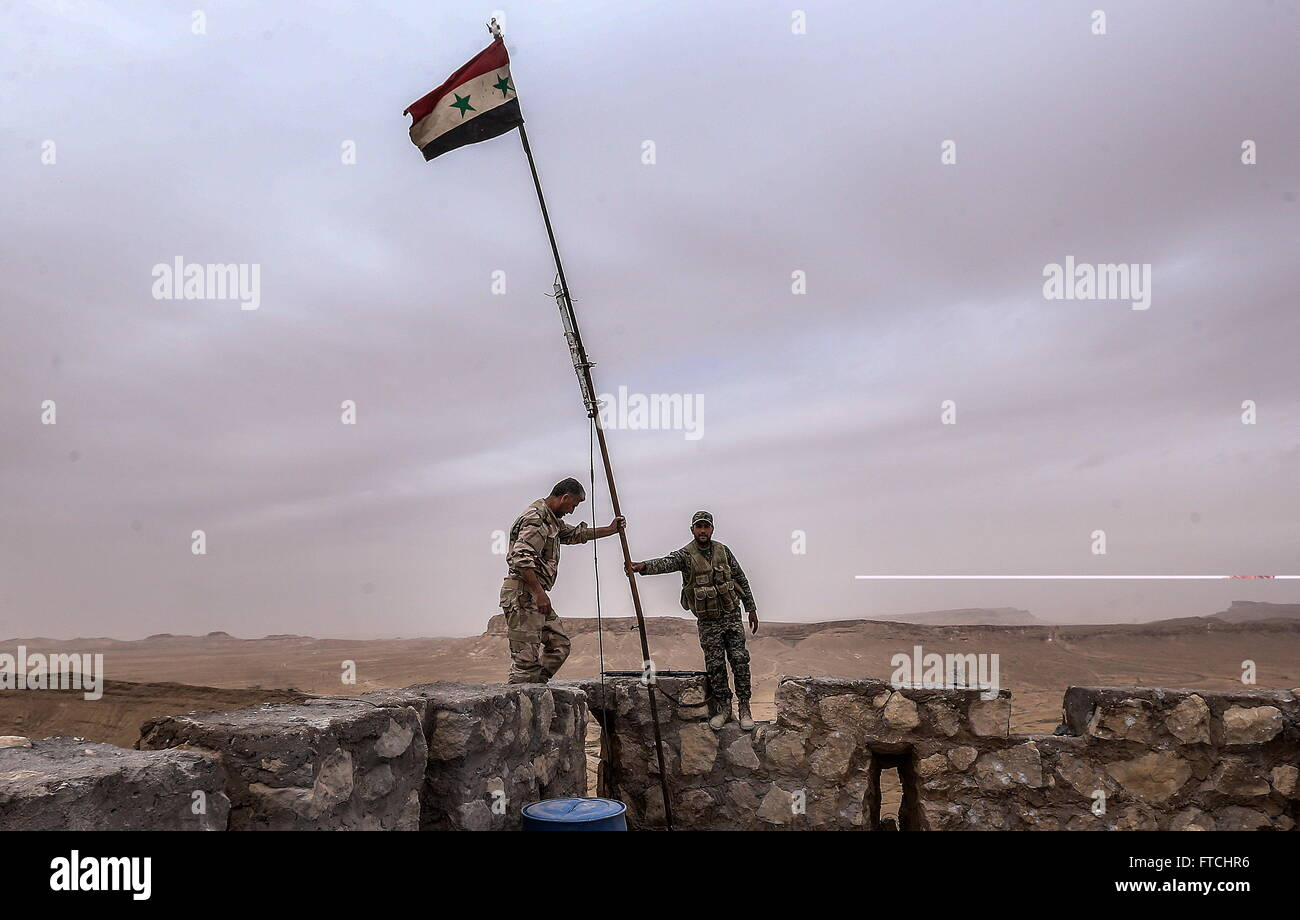 Palmyria, Syria. 26th Mar, 2016. Syrian government army soldiers put a flag on top of Fakhr al-Din al-Maani Citadel, - Stock Image