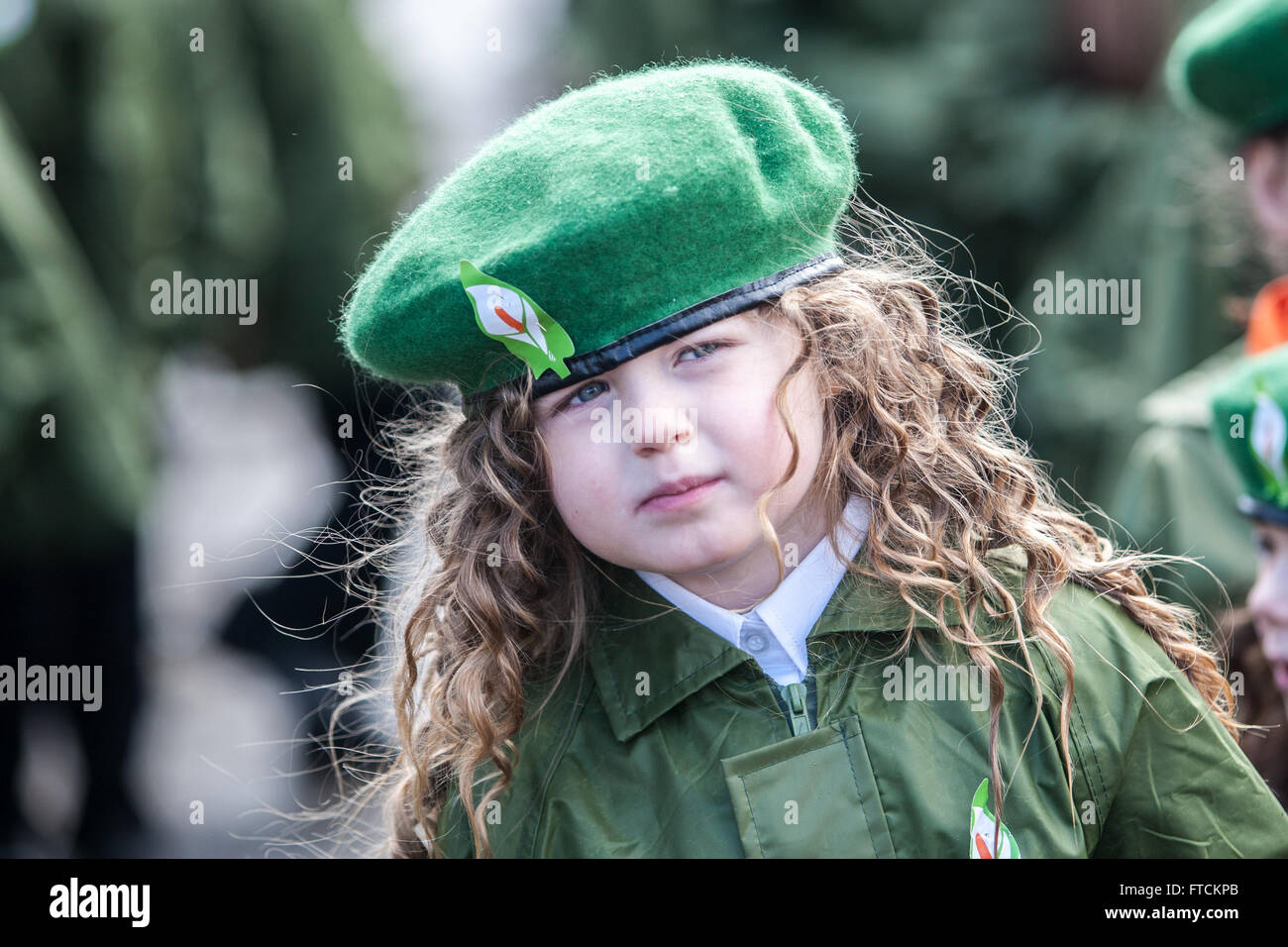 Falls Road, Belfast,UK 27th March 2016 A young girl wearing a green beret with Easter Lilly Easter Rising 100th - Stock Image