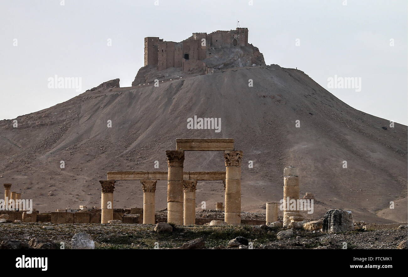 PALMYRA, SYRIA. MARCH 27, 2016. Ruins in Palmyra, a UNESCO world heritage site, with Fakhr al-Din al-Maani Citadel - Stock Image