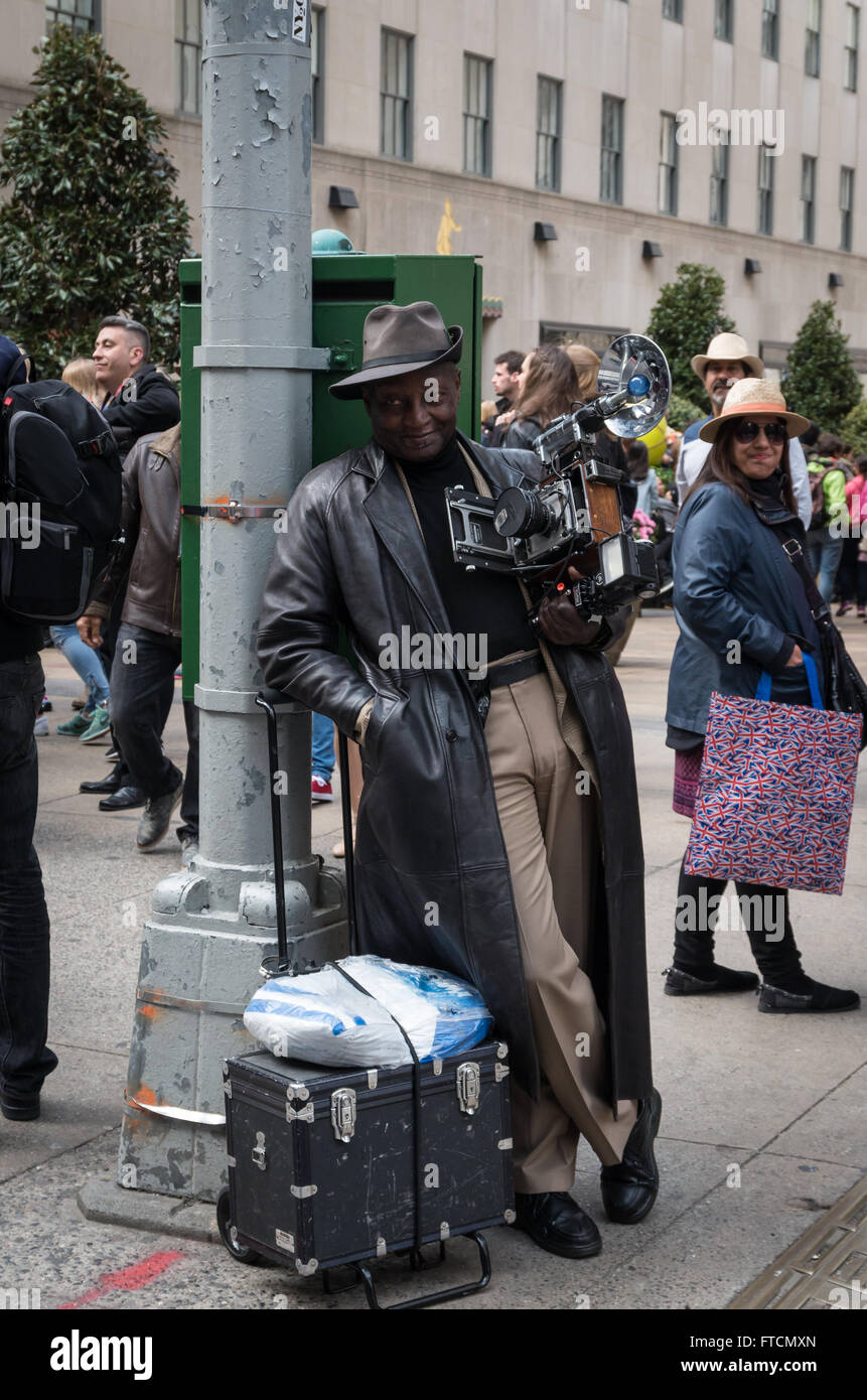 A man dressed as a  1930's photographer at the annual Easter Parade and bonnet festival in New York City - Stock Image