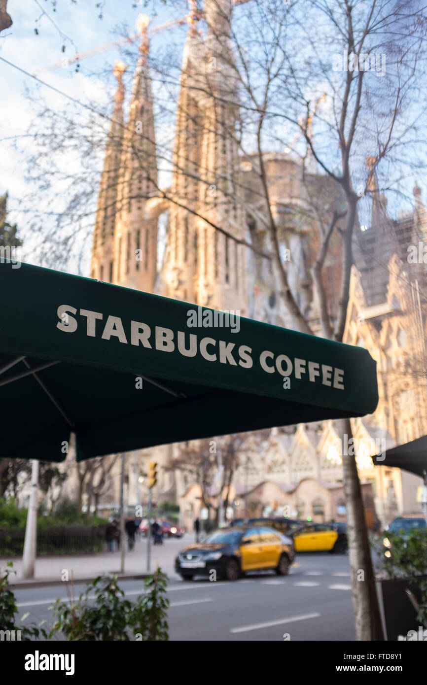 Starbucks coffee shop next to the Sagrada familia cathedral in Barcelona Spain - Stock Image