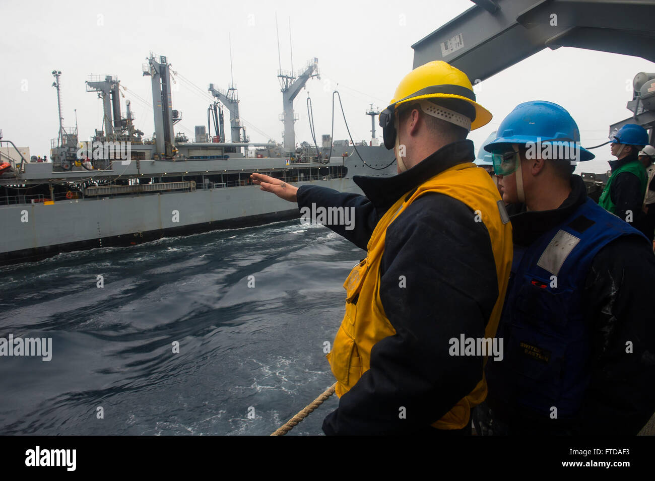 150323-N-FQ994-064 MEDITERRANEAN SEA (March 23, 2015)  Sailors aboard USS Ross (DDG 71) analyze an ongoing underway - Stock Image