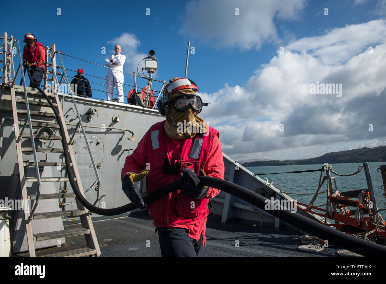 150325-N-JN664-029 PLYMOUTH, England (March 25, 2015) Sailors aboard USS Donald Cook (DDG 75) participate in a simulated Stock Photo