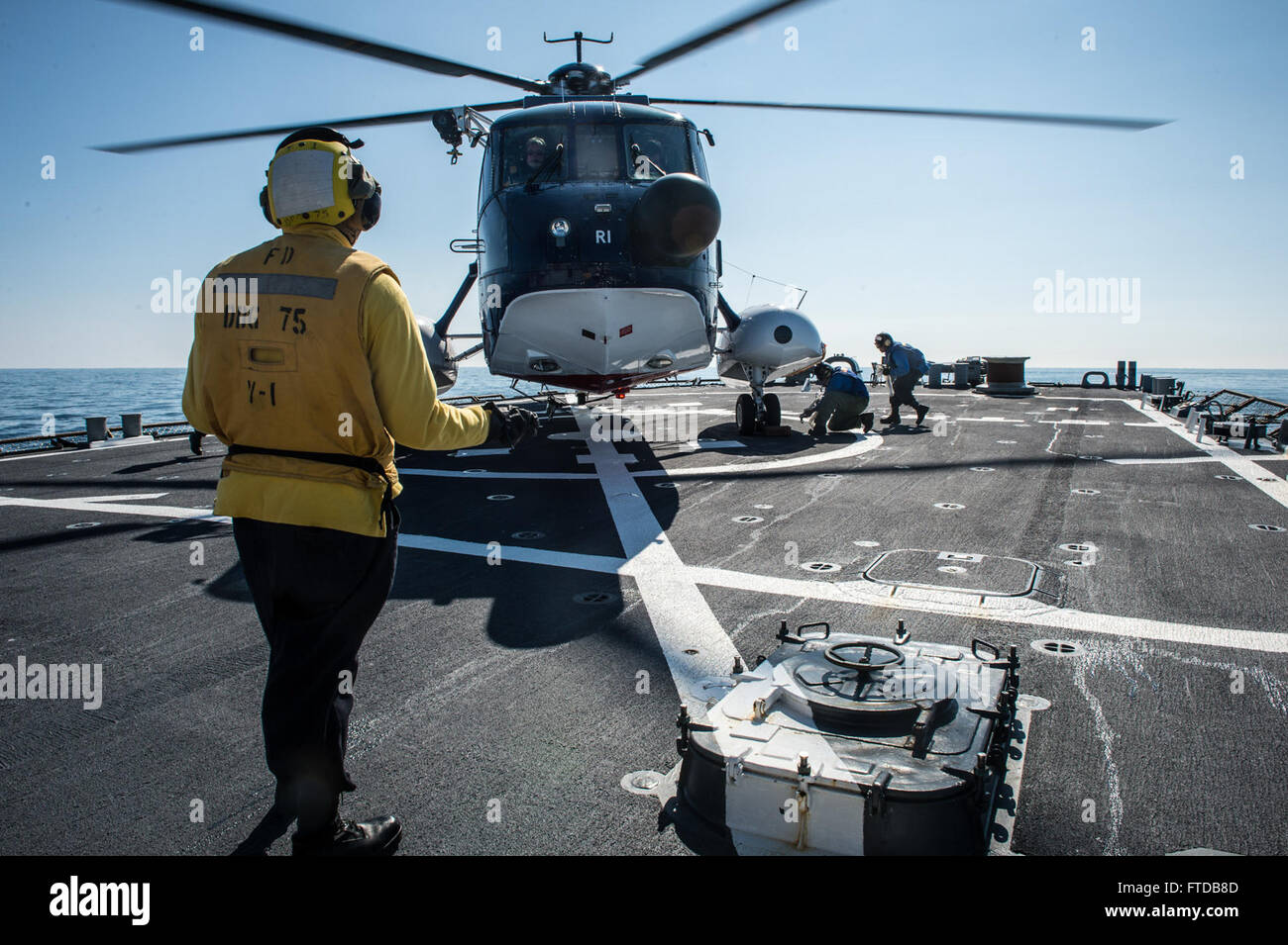 150406-N-JN664-025 ATLANTIC OCEAN (April 6, 2015) USS Donald Cook (DDG 75) conducts flight operations with a Sikorsky Stock Photo