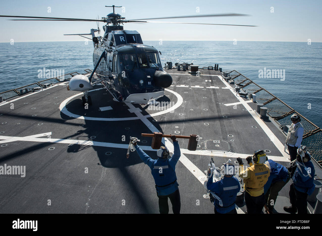 150406-N-JN664-093 ATLANTIC OCEAN (April 6, 2015) USS Donald Cook (DDG 75) concludes flight operations with a Sikorsky Stock Photo