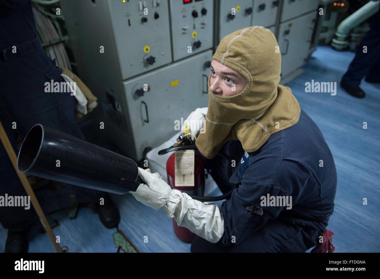 131008-N-UD469-082: MEDITERRANEAN SEA (Oct. 8, 2013) - Machinery Repairman 2nd Class Robert Briggs prepares to fight Stock Photo