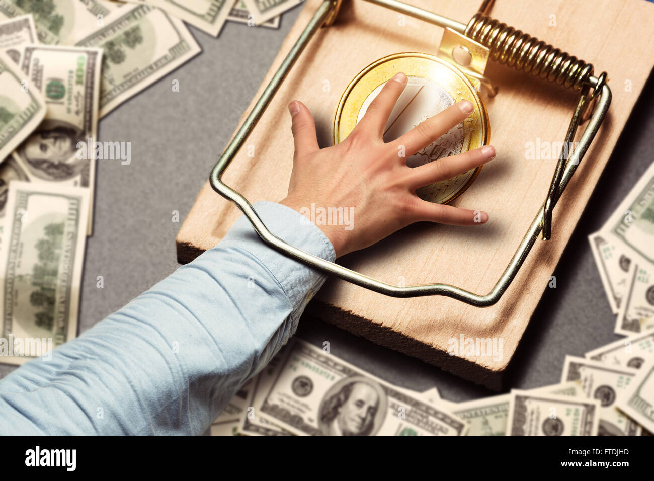 Male hand picking a gold coin - Stock Image