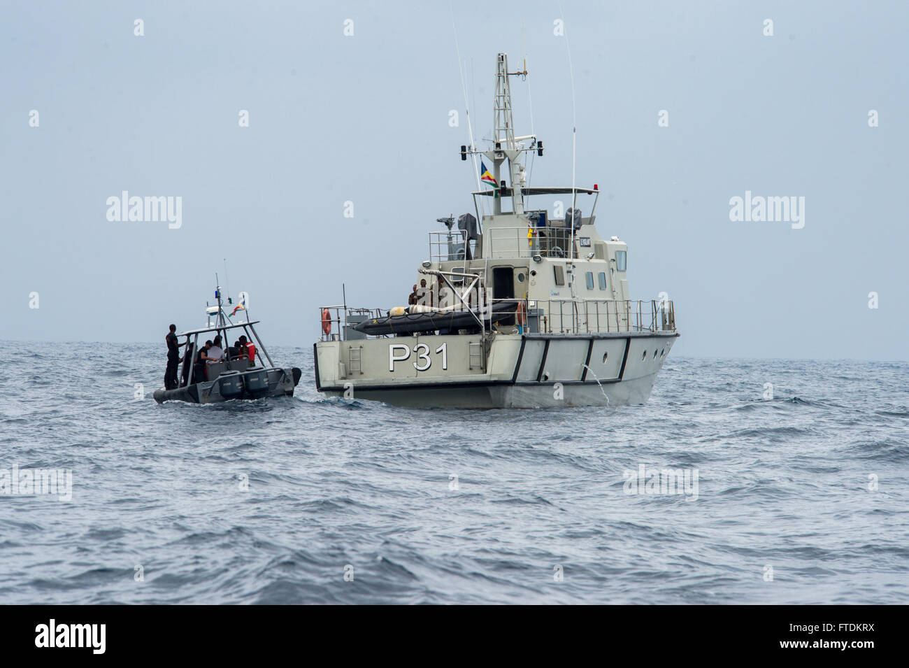160202-N-TC720-120 PORT VICTORIA, Seychelles (Feb.2, 2016) -Maritime forces from Seychelles pilot a rigid hull inflatable Stock Photo