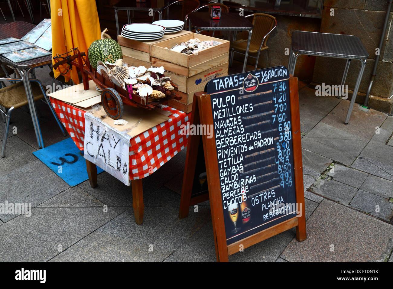 Spanish language menu with prices in Euros outside typical seafood restaurant / cafe, Vigo, Galicia, Spain Stock Photo