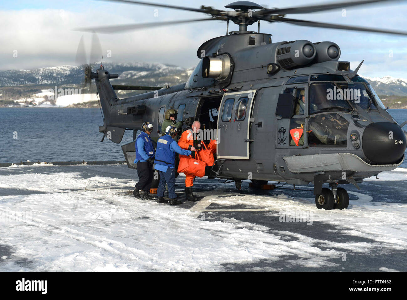 160308-N-AH771-154 NAMSOS FJORD, Norway (March 8, 2016) Dutch Naval officers come aboard the Whidbey Island-class Stock Photo
