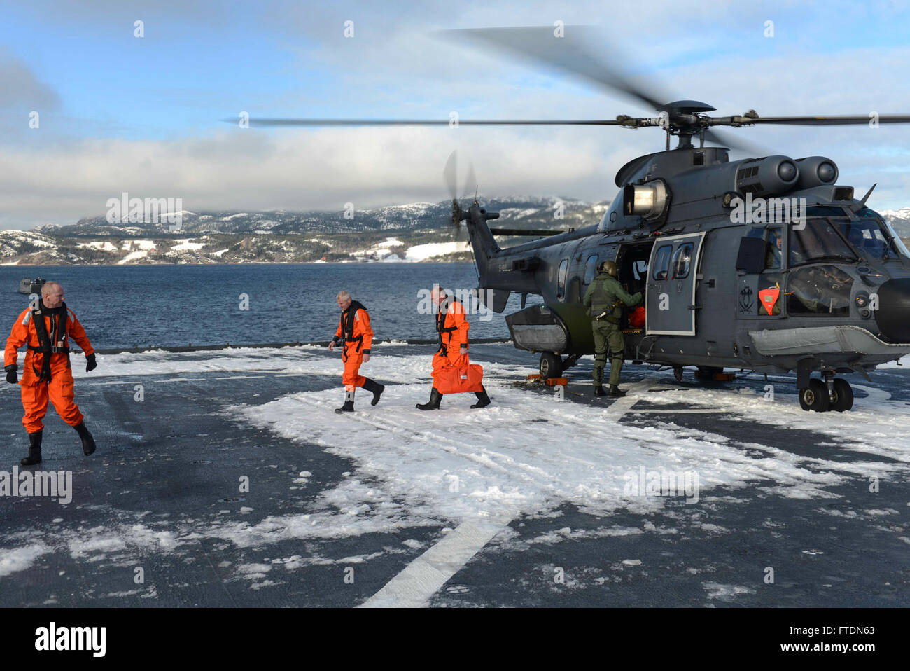 160308-N-AH771-173 NAMSOS FJORD, Norway (March 8, 2016) Dutch Naval officers come aboard the Whidbey Island-class Stock Photo