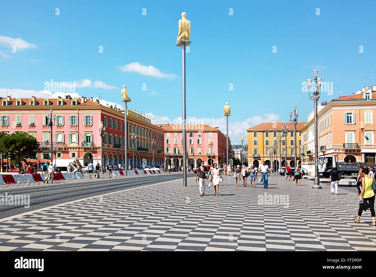 People walking on Place Massena in Nice, France. - Stock Image