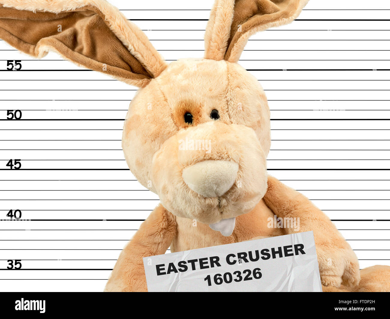 criminal easter bunny in the police station - Stock Image