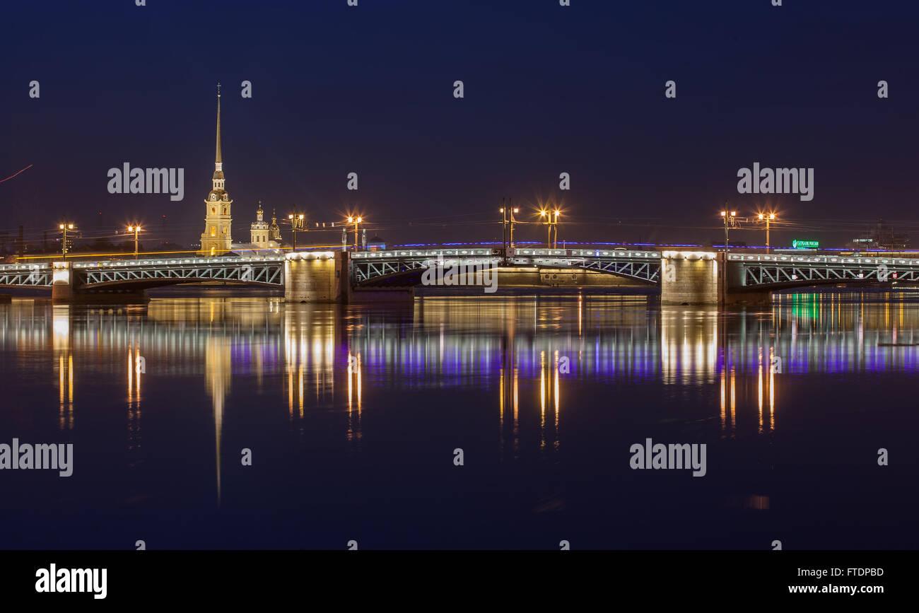 Neva river, Peter and Paul Cathedral, Palace bridge at night - Stock Image