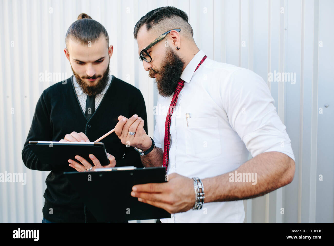 Two businessmen discussing something - Stock Image