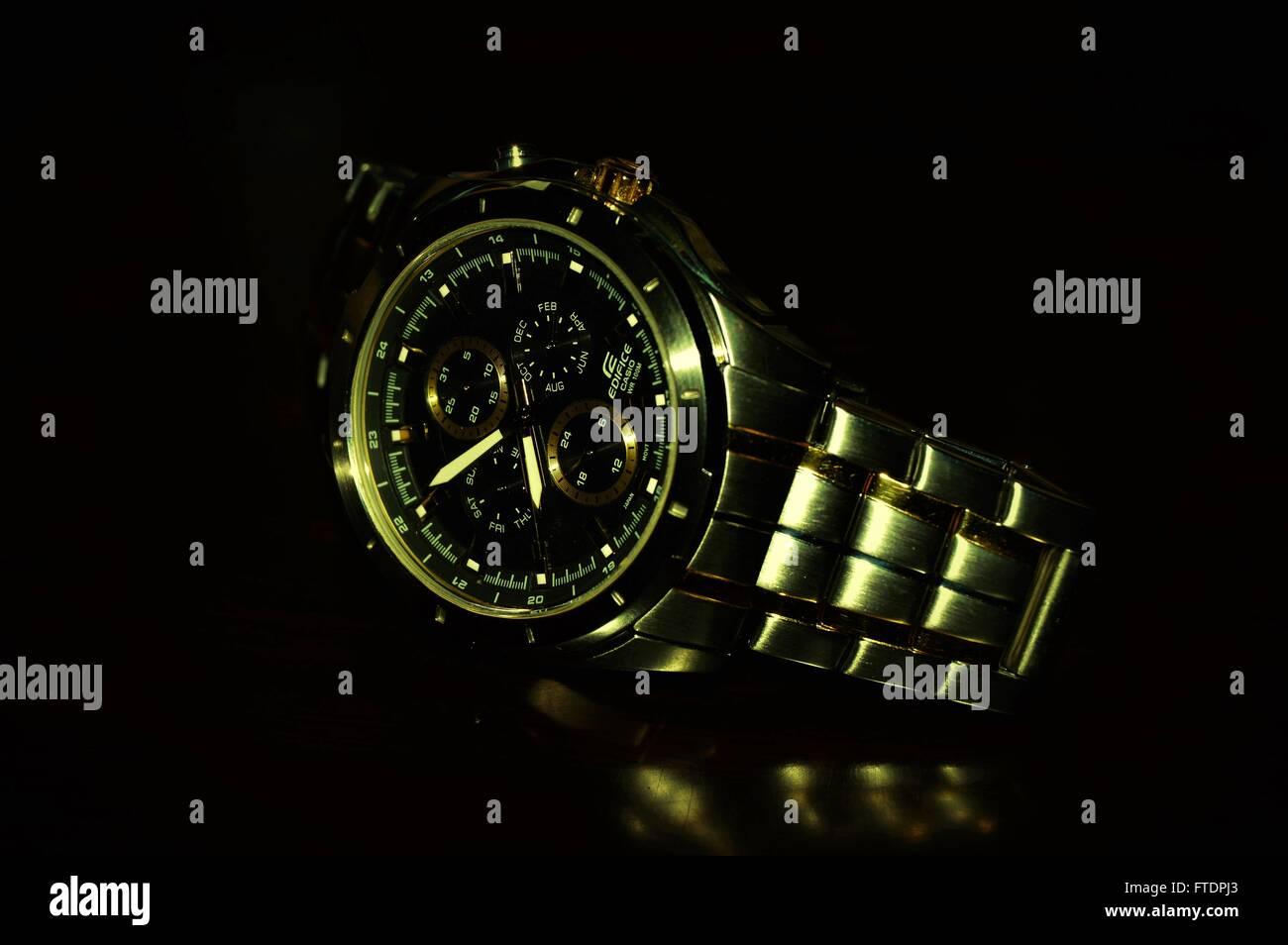 Edifice, Watch,black,eight,golden, chain - Stock Image