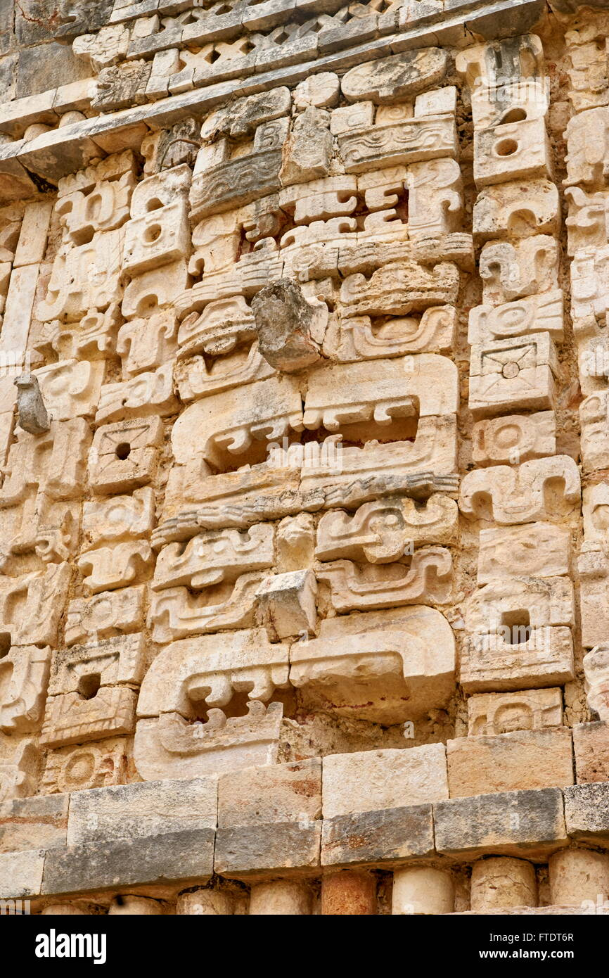 Stone sculpture on the temple, Ancient Maya Ruins, Nunnery Quadrangle, Yucatan,  Mexico - Stock Image