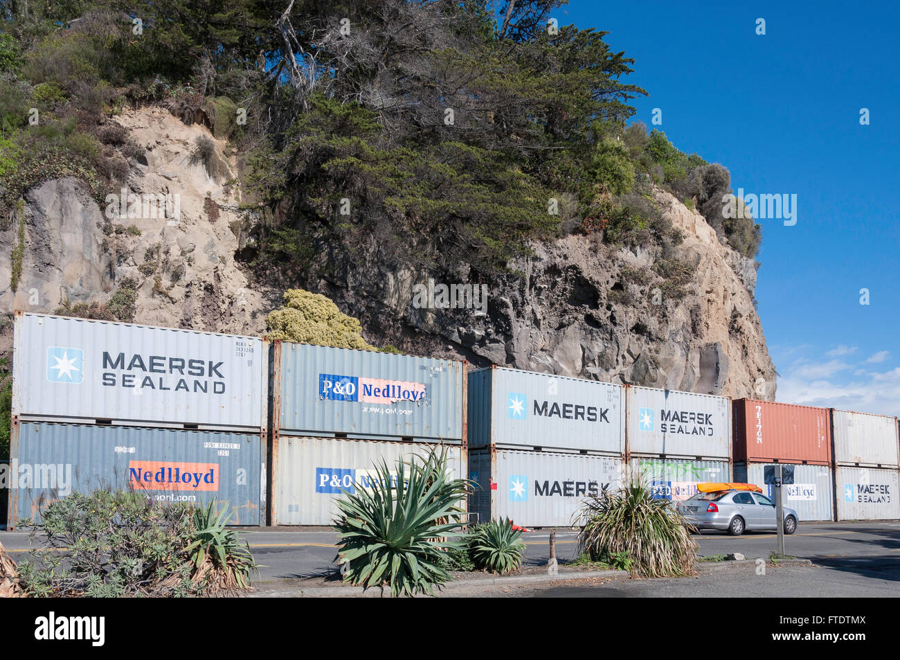 Shipping containers stacked to prevent earthquake rock fall, Esplanade, Sumner, Christchurch, Canterbury Region, - Stock Image