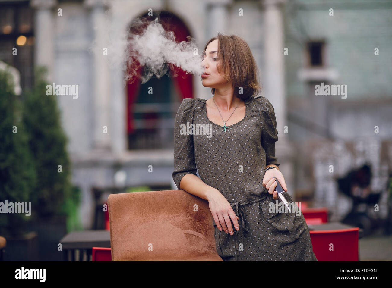 girl with E-cigarette - Stock Image