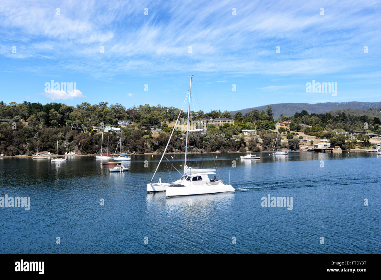 Catamaran sailing past Kettering, Tasmania, Australia - Stock Image