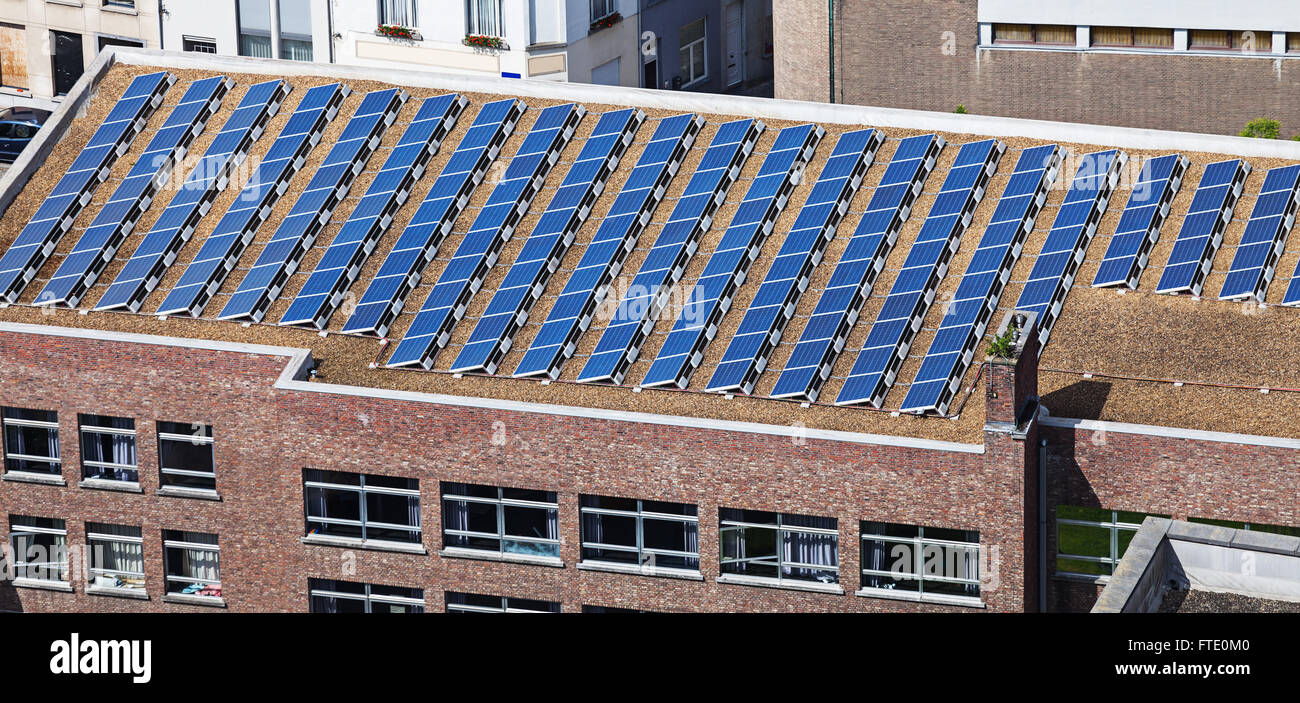 solar panels on the roof of administrative building - Stock Image