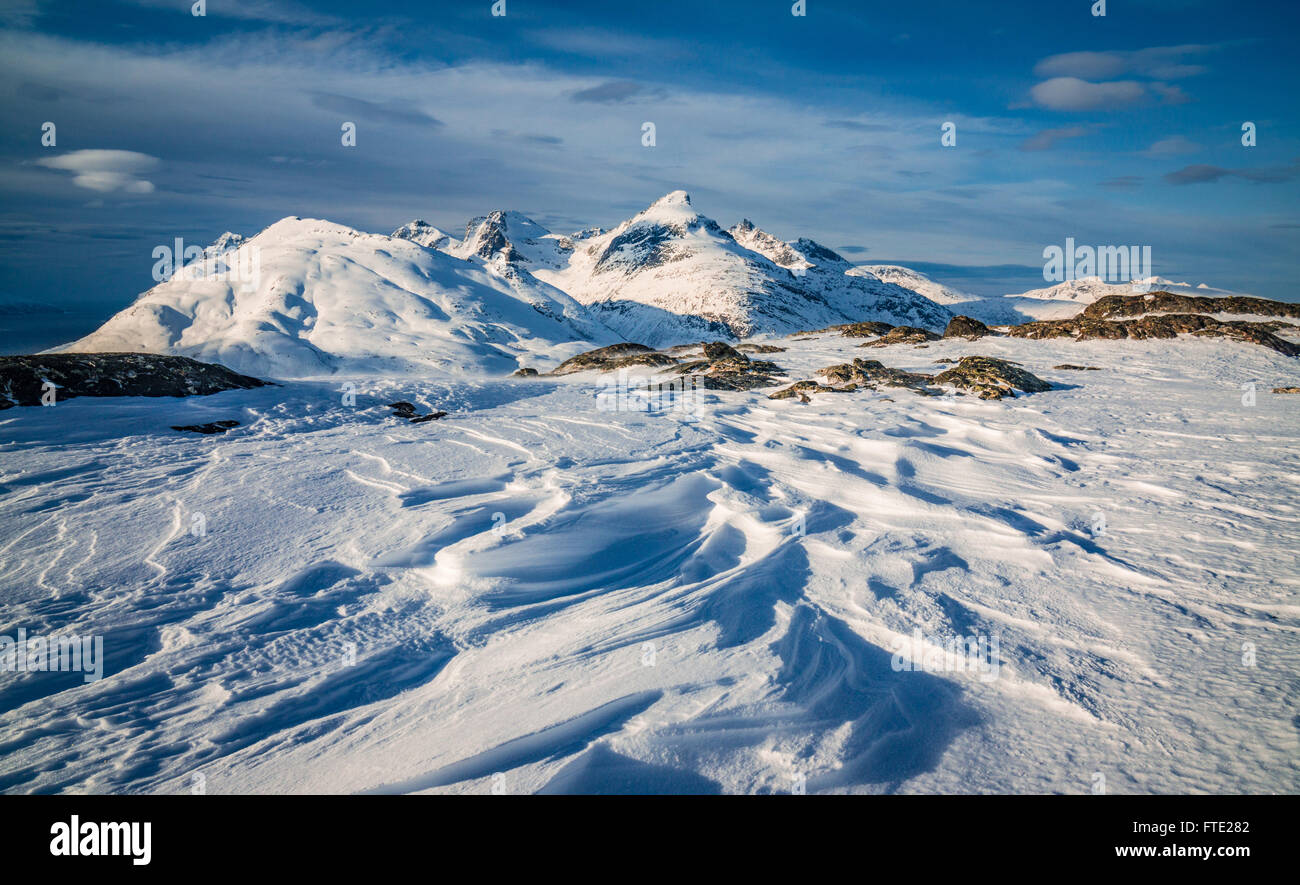 Wind sculpted sastrugi and Store Blamann view, Kvaloya, Northern Norway - Stock Image